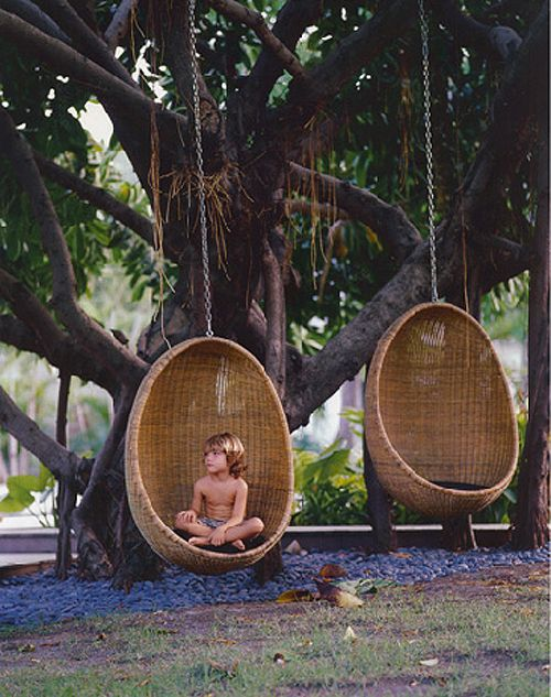 child in hanging egg chair.jpg