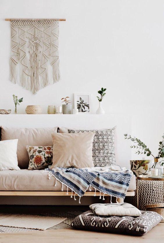 Sofa with wall hanging and blush pink cushions .jpg
