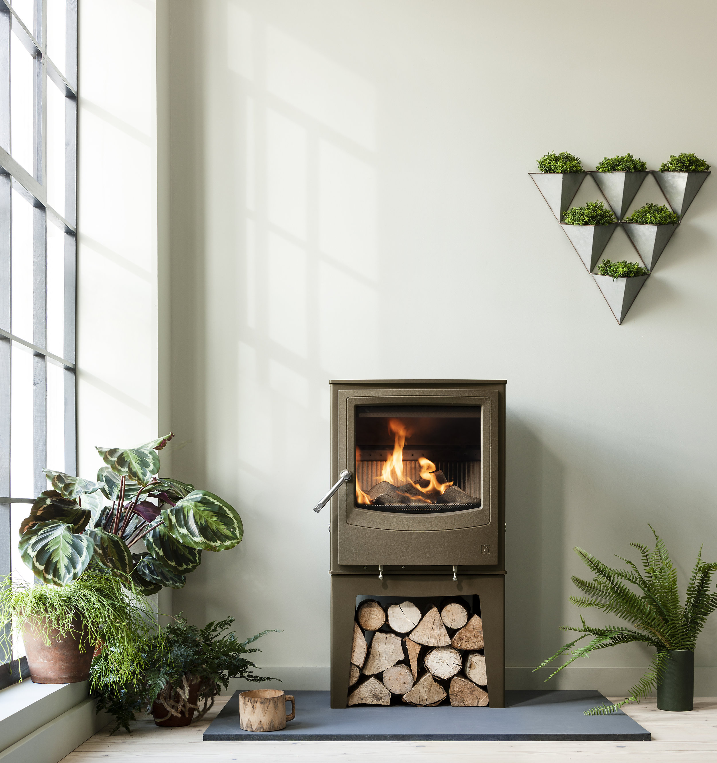 Sage - Pinterest has named sage the most 'up-and-coming' colour of the season, with saves for posts containing the colour up by 170 percent. We think its pale, cool tones make it ideal for use as a modern neutral in your home; abandon the traditional beiges and whites, and opt for blonde woods and whites to create a minimal, natural look. Natural shapes and colours are an increasingly popular trend. While technology is trading its stringent angles for softened curves, subtle green hues have found their way on to catwalks and into our homes. This wood-burning stove from Arada in chestnut brown compliments the soft sage colour palette to create a natural, autumnal space.