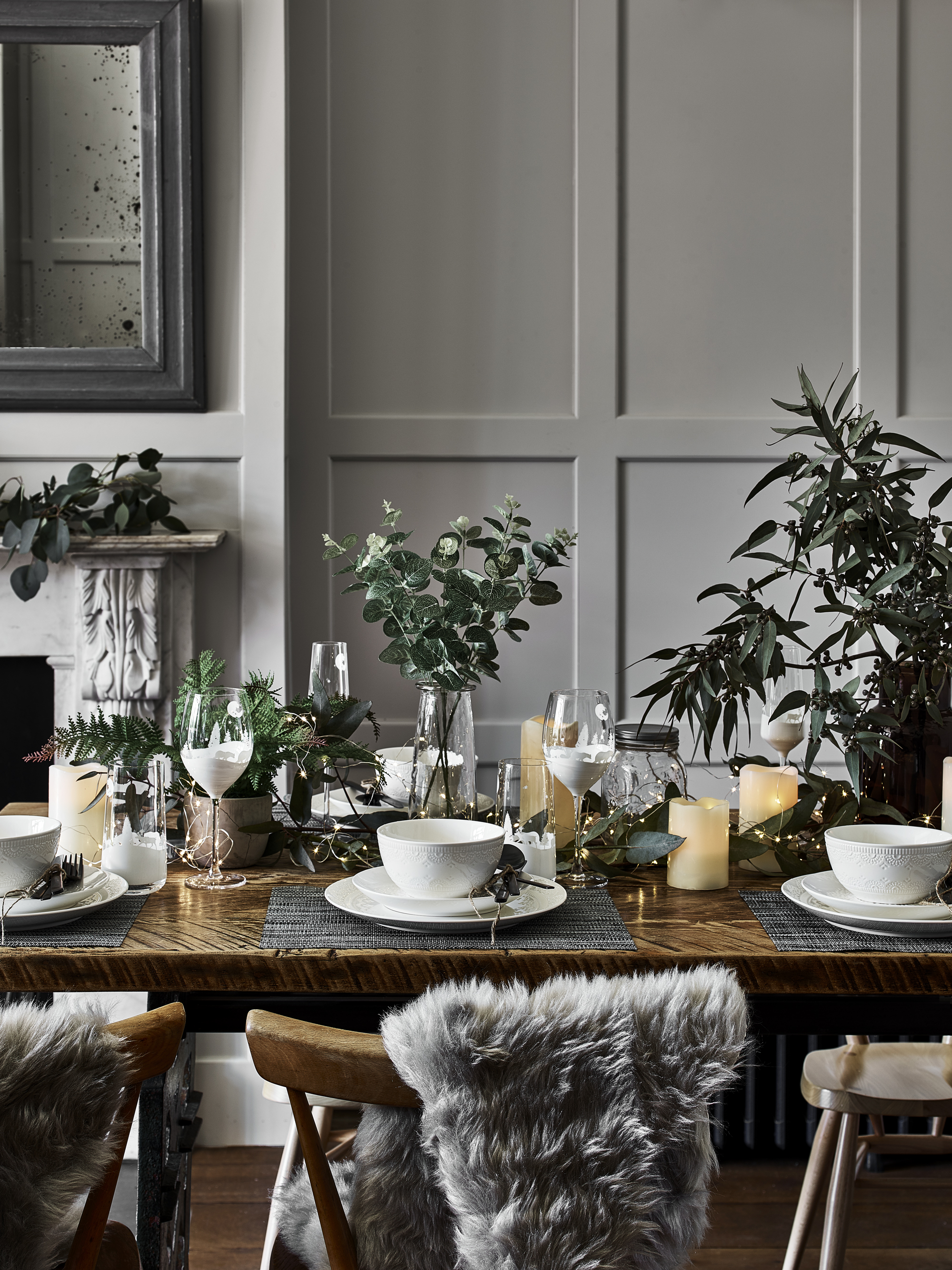 Nordic Wonderland - A minimalist twist on the traditional, the Nordic trend is full of cream ornaments, natural textures and forest-green accessories. To achieve the look, fill your home with wooden carved stag heads, cream ceramics and faux fur throws. We'll be shopping the Nordic range from Asda to achieve this Scandinavian-inspired elegance on a budget. Image: George Home