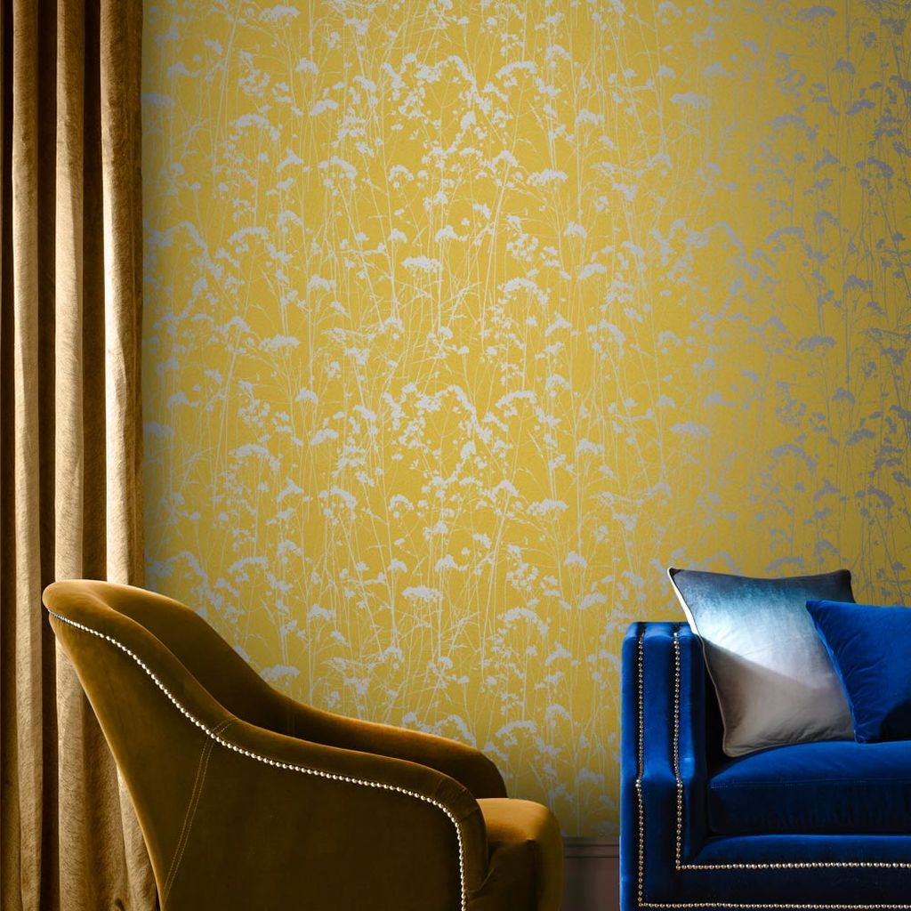 Grace from Graham & Brown - A fresh take on traditional design, the Grace wallpaper collection embraces the natural world with a pattern straight from the free flowing meadows of summer. Available in six bold colour combinations, each wallpaper combines a bright background with shimmering metallic silhouettes that catch the light, day or night. £50.00Image: Graham & Brown