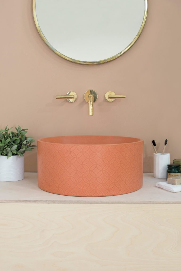 Mara Ember Basin - Combining the industrial trend with an easy-going colour palette, the circular Mara Basin in Ember from Kast Concrete Basins features a subtle geometric detailing on the outer surface of the bowl. Ideal as a cloakroom or smaller bathroom statement piece, the soft burnt orange tone looks perfect when paired with brass taps and accessories.www.kastconcretebasins.com