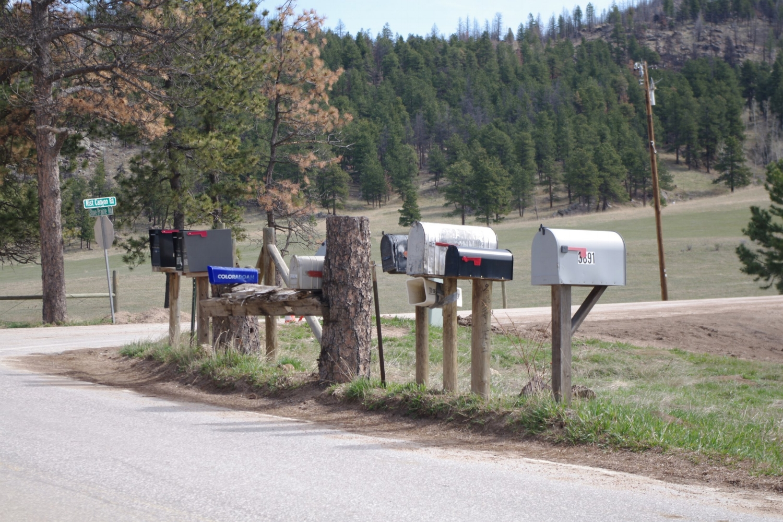 Signs of rural neighborhood on Stove Prairie Road.