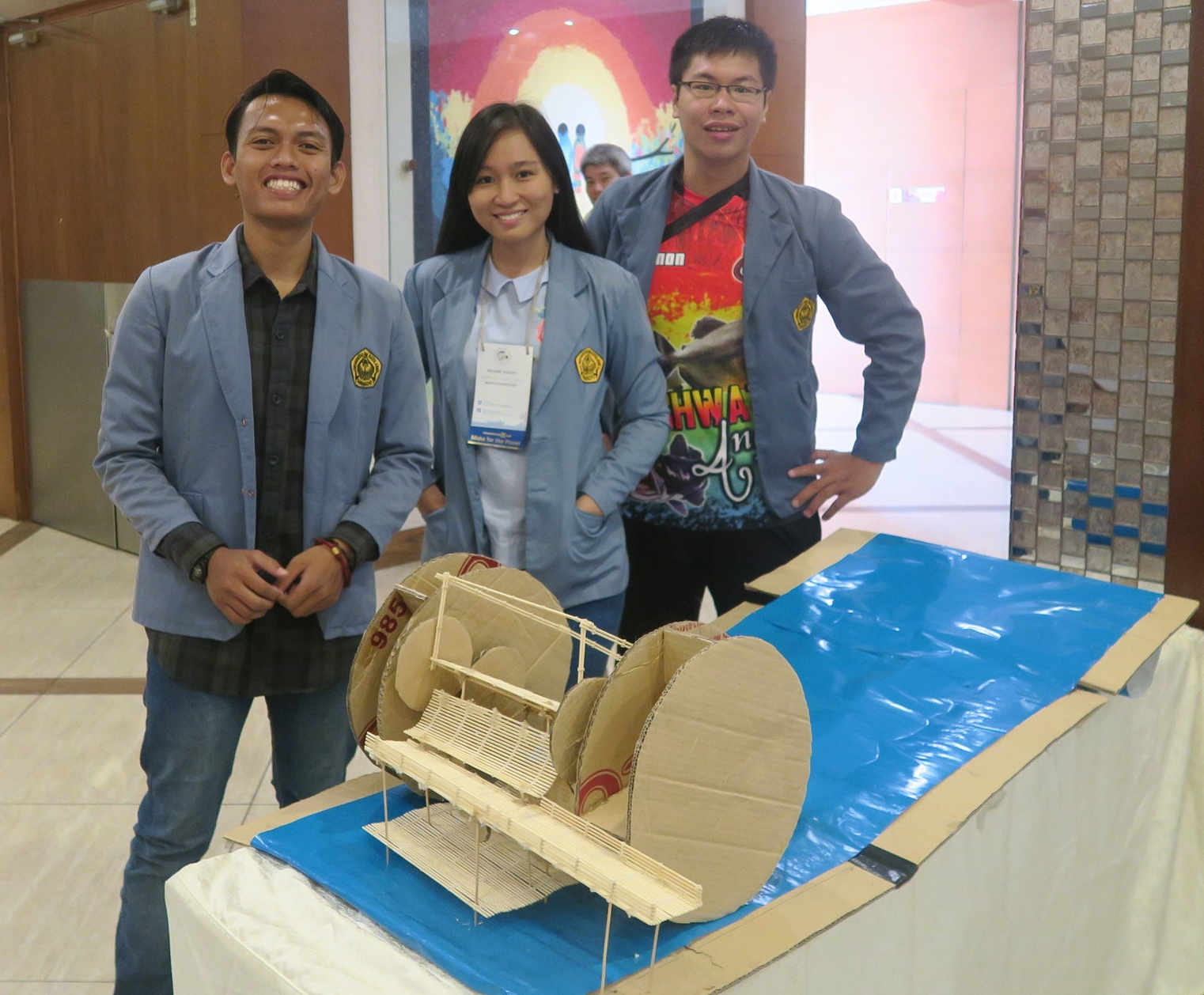 Team Sea Warrior with a model of the Winseal Watermill.