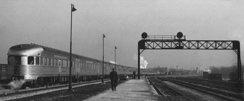 In March of 1950, the  Babbling Brook  is on the rear of New York Central train No. 28 (the eastbound  New England States ) as it departs Englewood, IL.