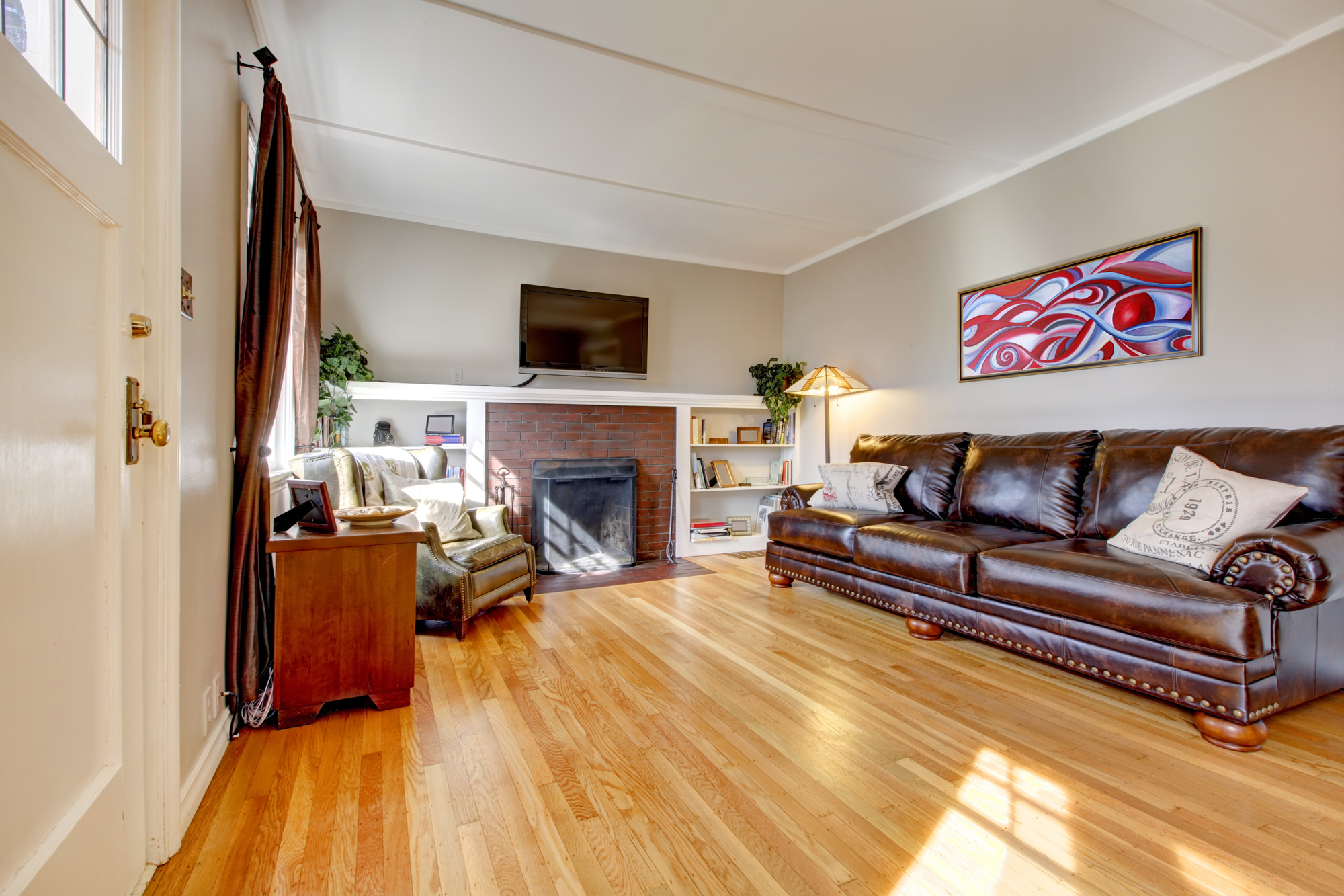 Wood Floor Leather Couch.jpg