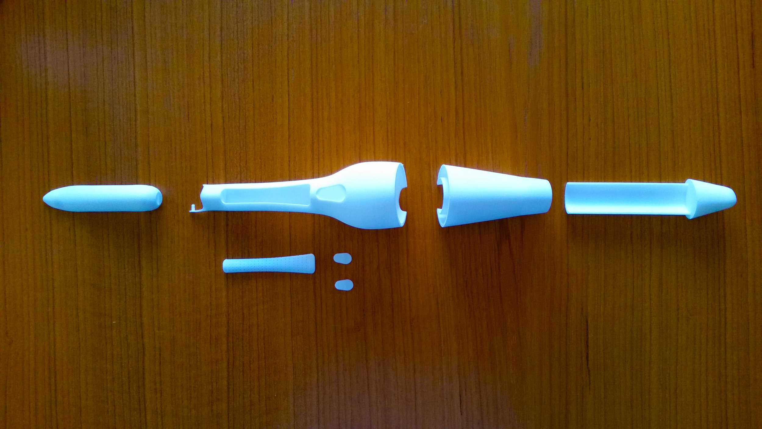 After modeling in Solidworks, parts were 3-D printed using Shapeways white, strong, and flexible material (Nylon).