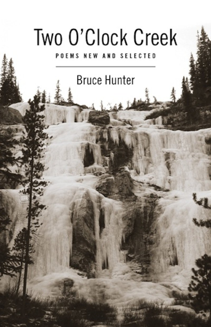 (Image: Black and white cover of  Two O'clock Creek . A frozen mountain waterfall with evergreen trees in the fore and background with the book title across the top.)