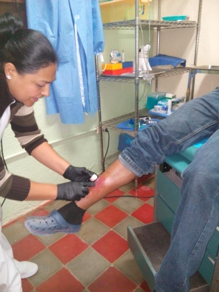 Jose is 24, our nurse, Gladys is treating a wound from a accident and teaching him how to care for it at home