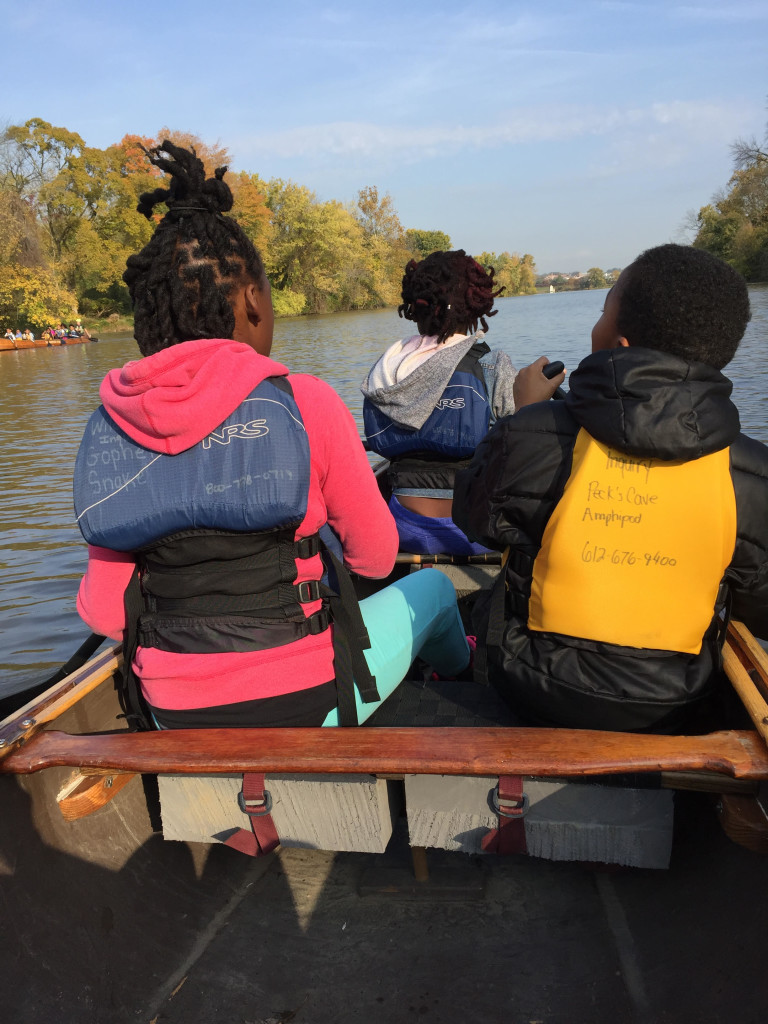 Students paddle together as part of Wilderness Inquiry's Canoemobile