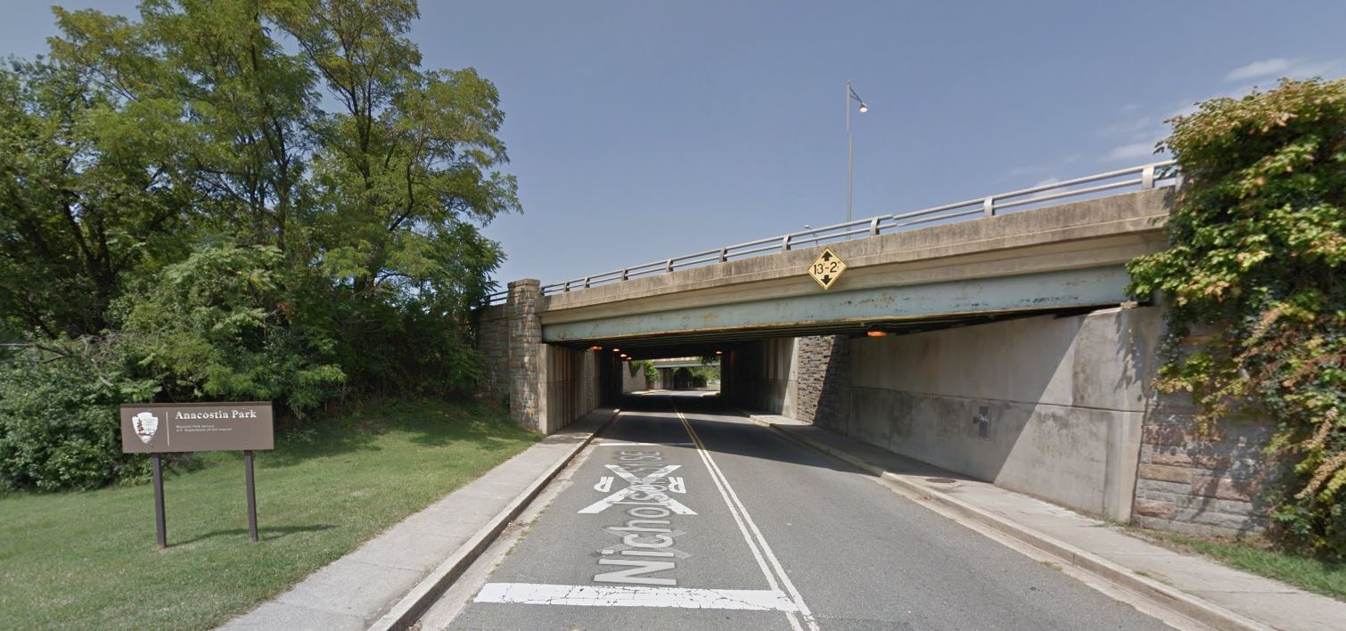 An underpass leading to Anacostia Park. While there are sidewalks and a sign indicating entrance to Anacostia Park, this entrance is not particularly inviting and it doesn't quite feel like a gateway into one of DC's signature waterfront parks.