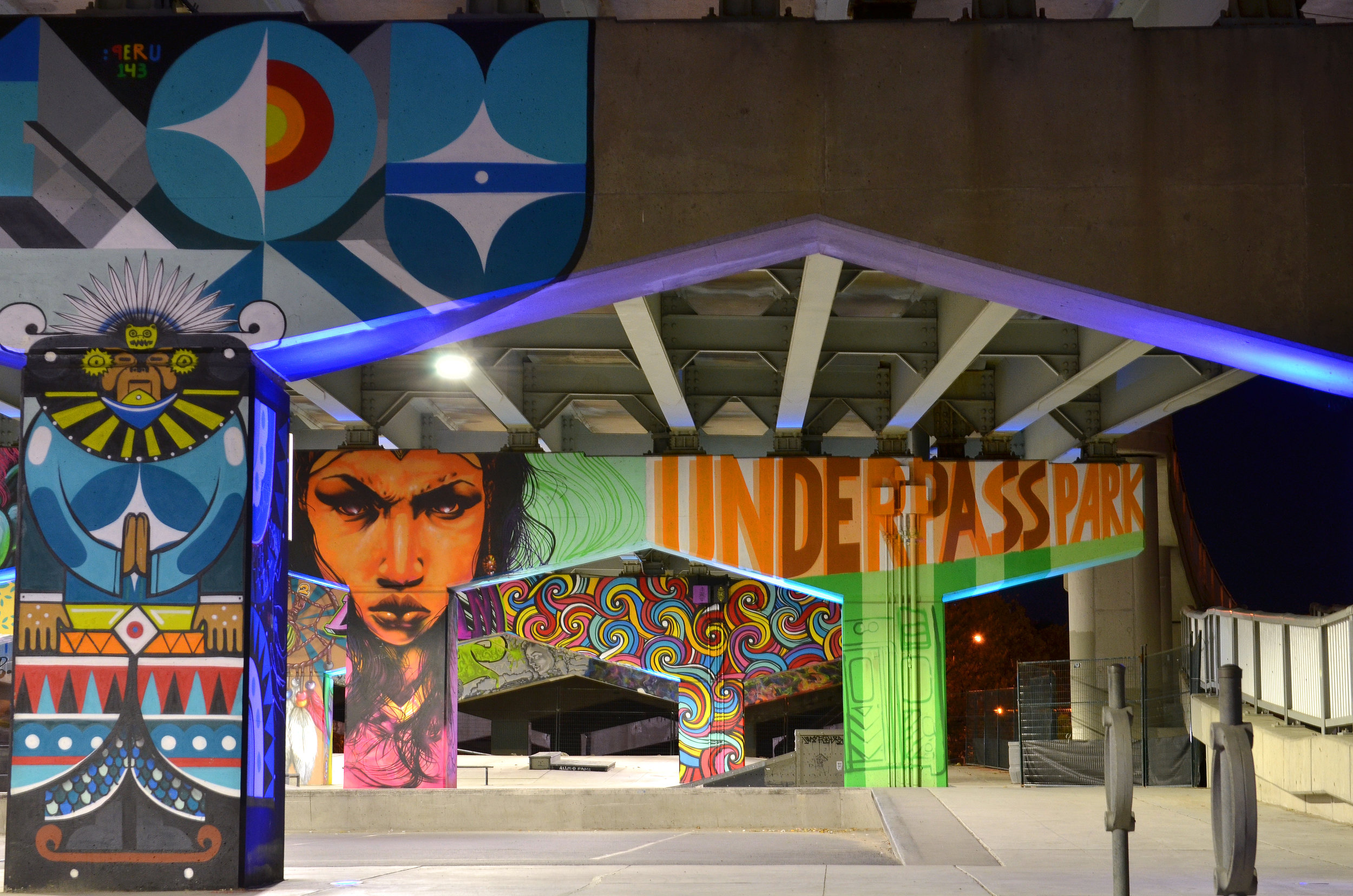 """From blog.waterfrontoronto.ca: """"The riotous graffiti artwork at Underpass Park takes full advantage of the imposing concrete beams and columns to create a fun and energetic atmosphere (Photo credit: Nicola Betts)."""""""