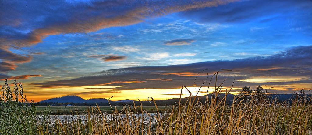 Fall sunsets along the Deschutes River, a short walk from QuiltSunriver.