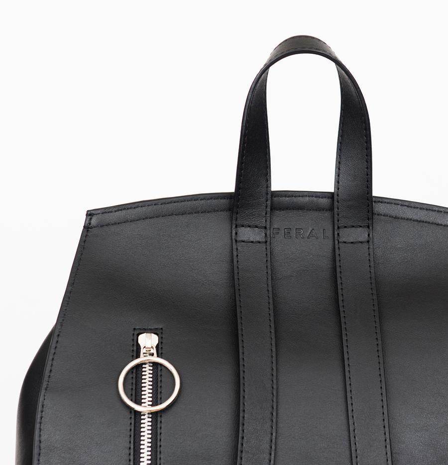 Feral designer hand bag