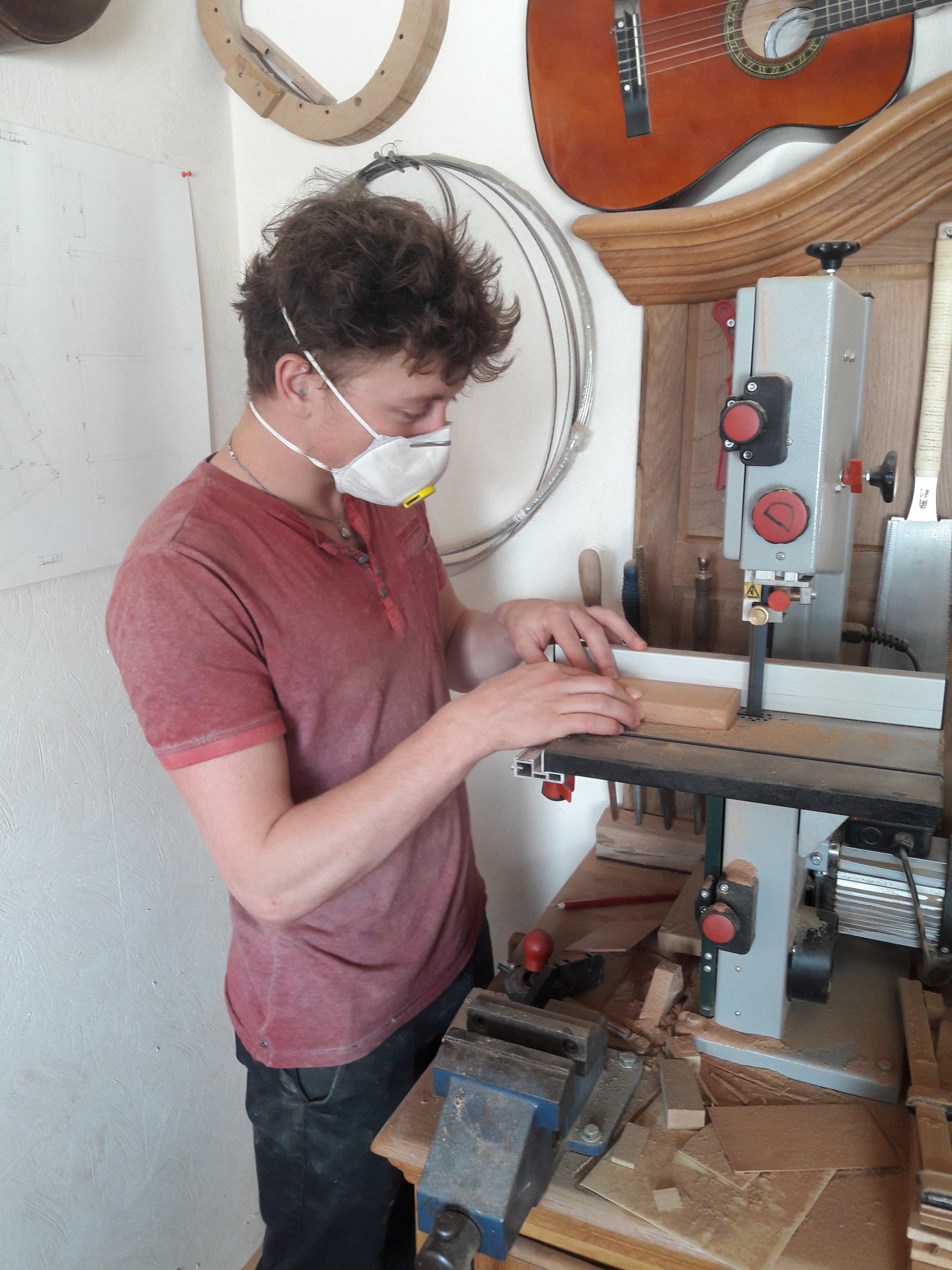 Bram cutting a blank of cedar.