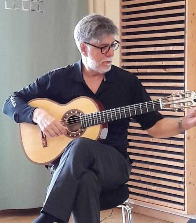 "Mark Delpriora Trying out Den Toom Luthier ""Ilona"" guitar in the Ligita guitar festival. Eschen, Liechtenstein."