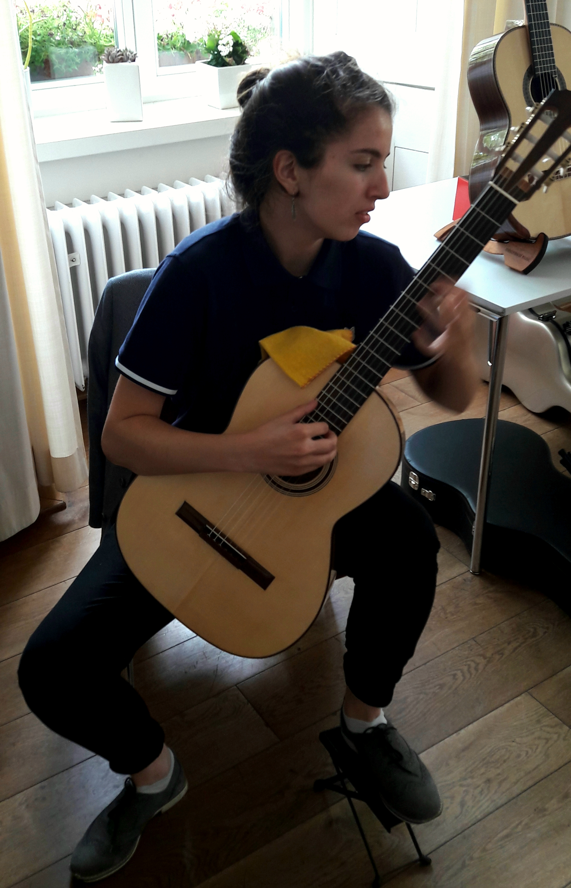 Farah Erfani with a maple version of a Den Toom Luthier guitar.