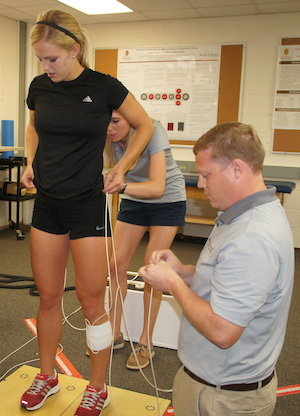 Assistant Professor of Kinesiology, David Bell in lab.