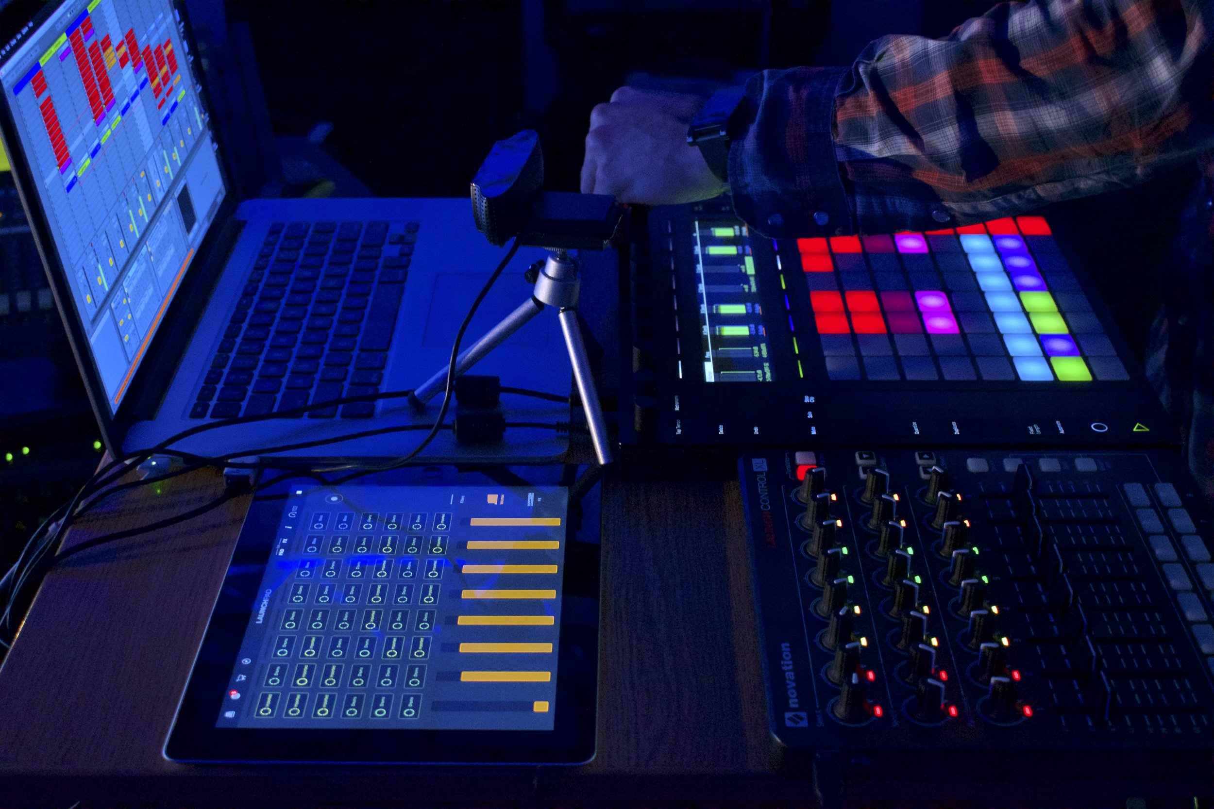 Figure 1 – Performance setup during Livestream events; Laptop using Ableton Live in conjunction with the Push 2 and the Novation's Launchpad Control XL, plus an iPad using Launchpad app in order to operate transitions from one piece to another in Live, 2017.