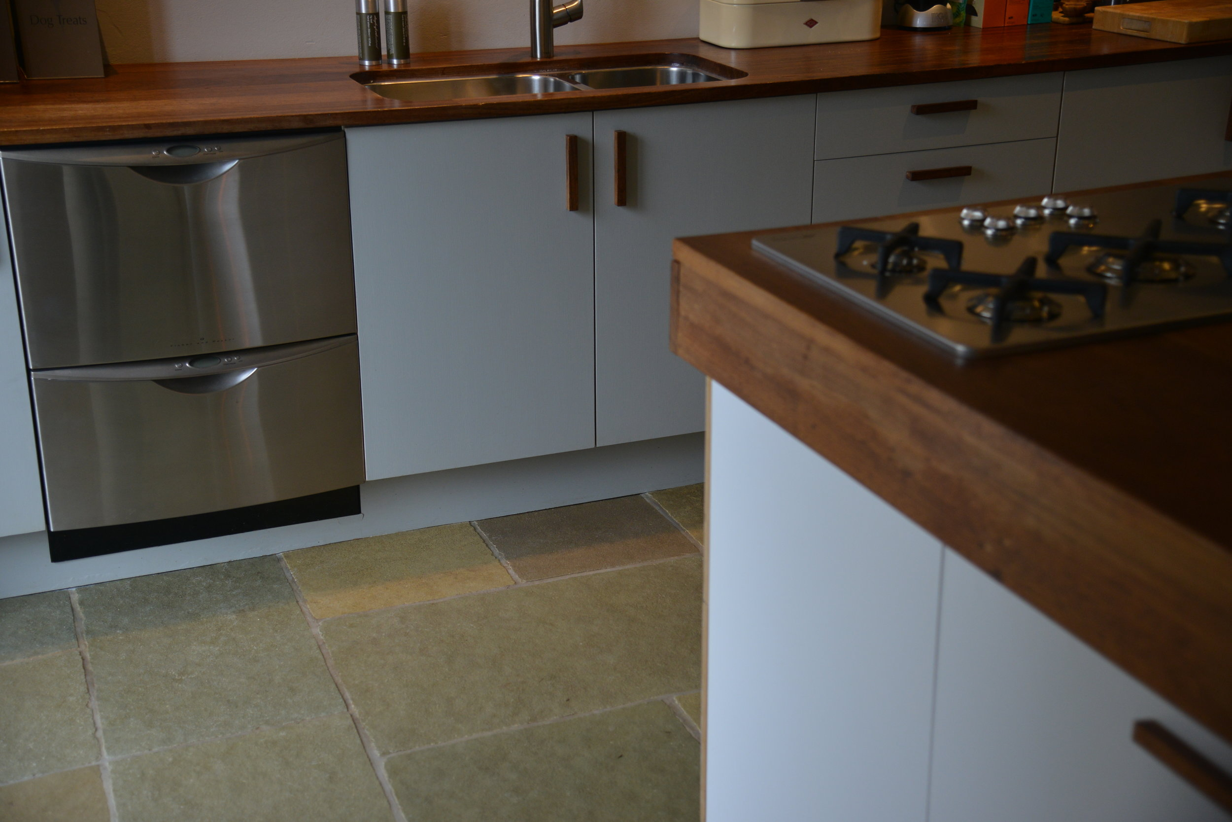 Painted birch plywood cabinets with handles made from iroko to match worktops.