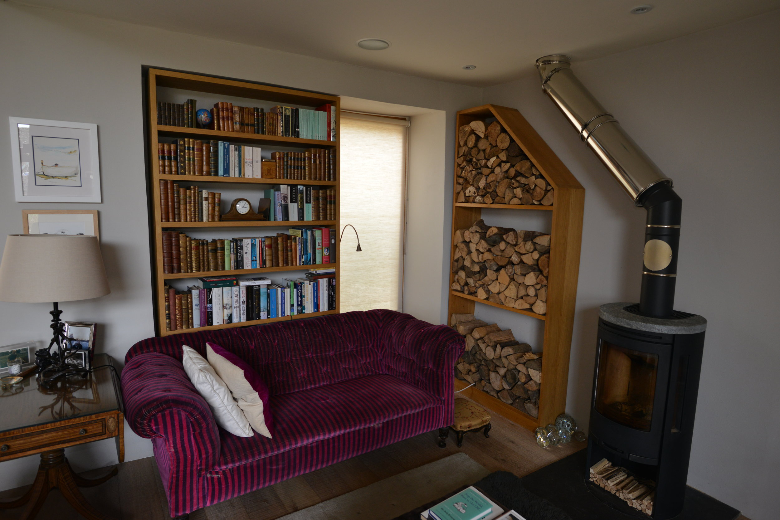 Logstore and bookcase in oak.