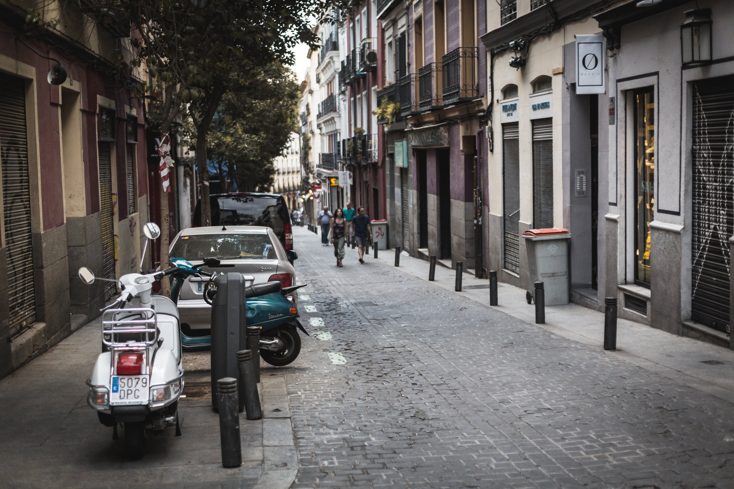Narrow streets and motorcycles are two features of El Centro of Madrid.