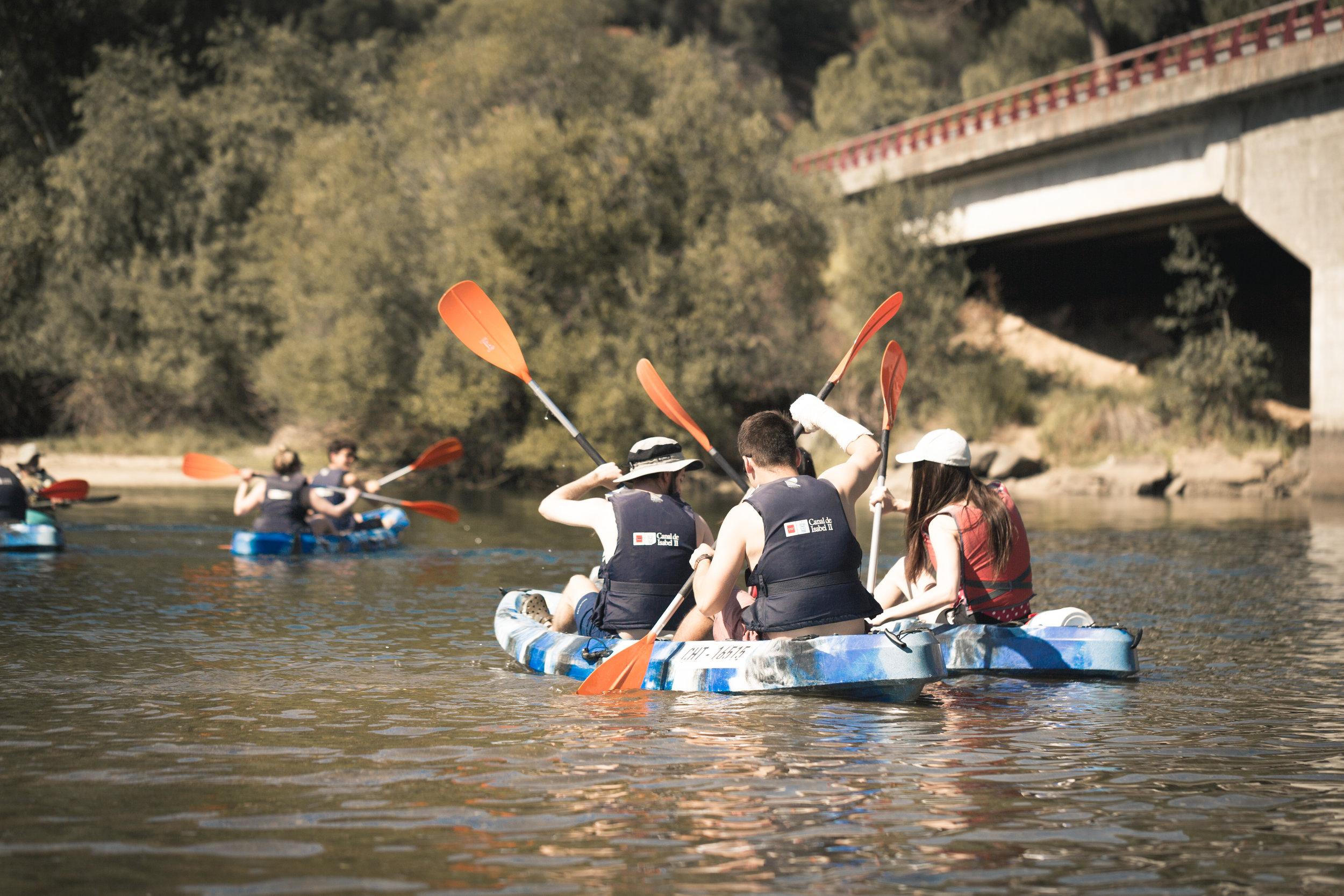 Fellows go kayaking at the Pantano San Juan, a popular lake destination just outside Madrid.