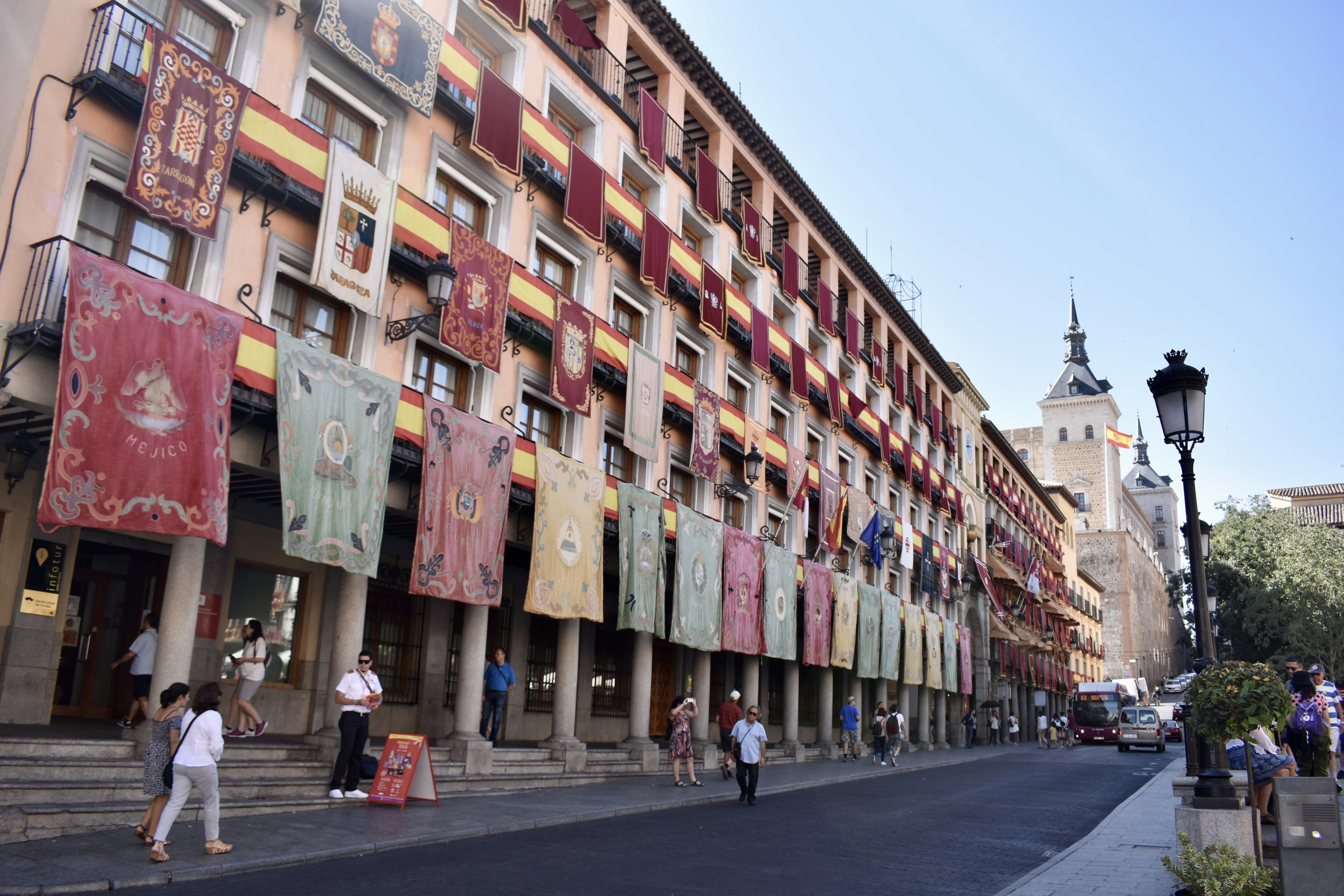 The central Plaza de Zocodover in Toledo displays dozens of decoratively hung flags.
