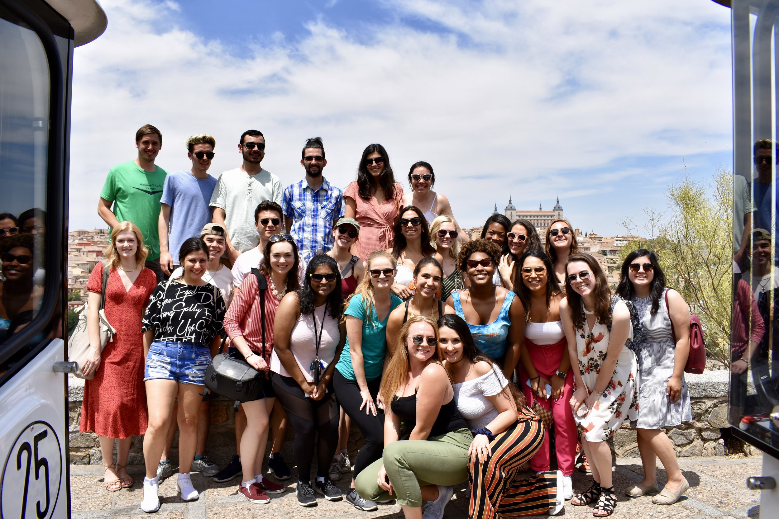 On a weekend excursion from Madrid, Fellows pose withe the casco of Toledo in the background, July 2019.