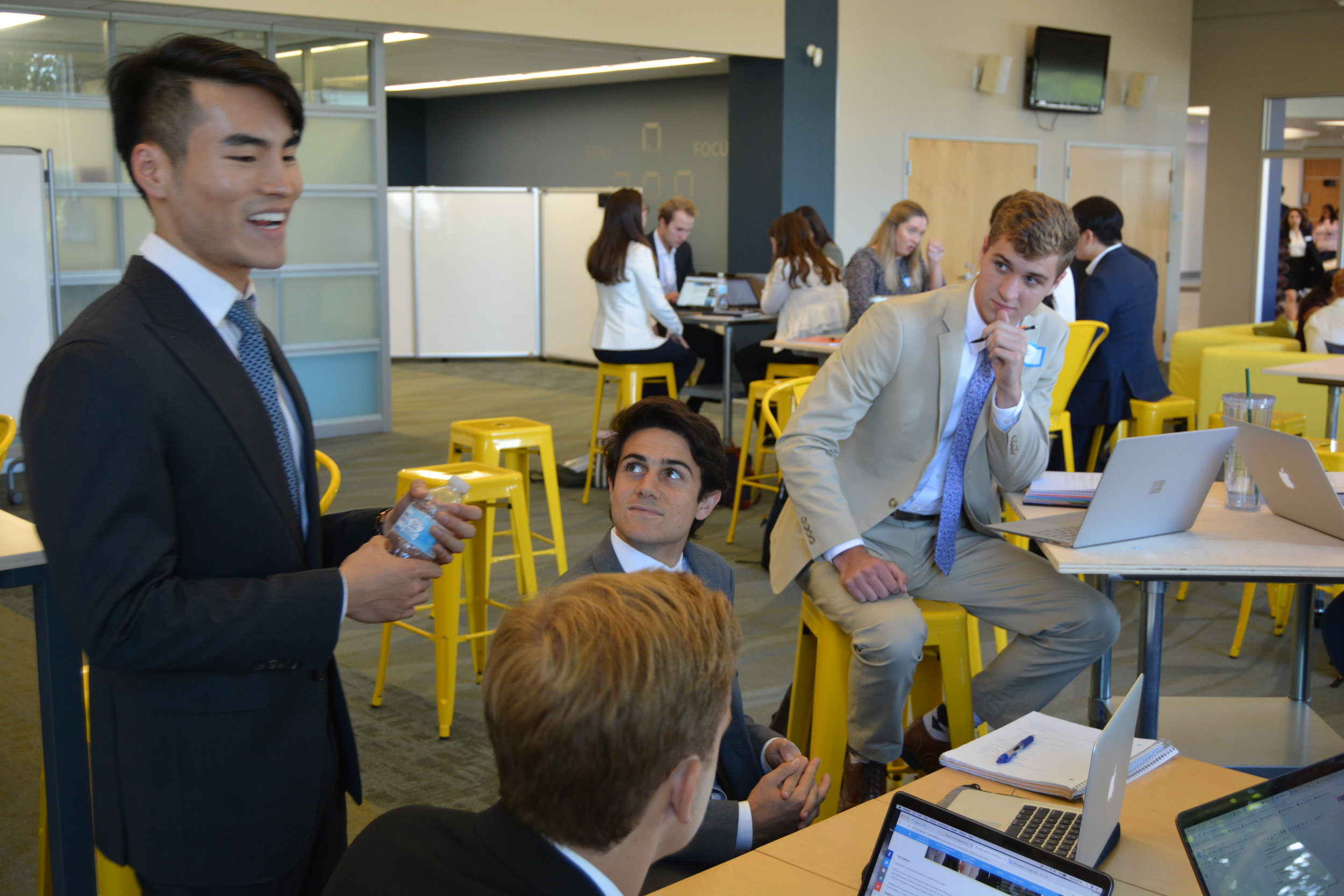 Viet, McKinsey alum & Harvard MBA candidate guides on consulting project during Notre Dame event.