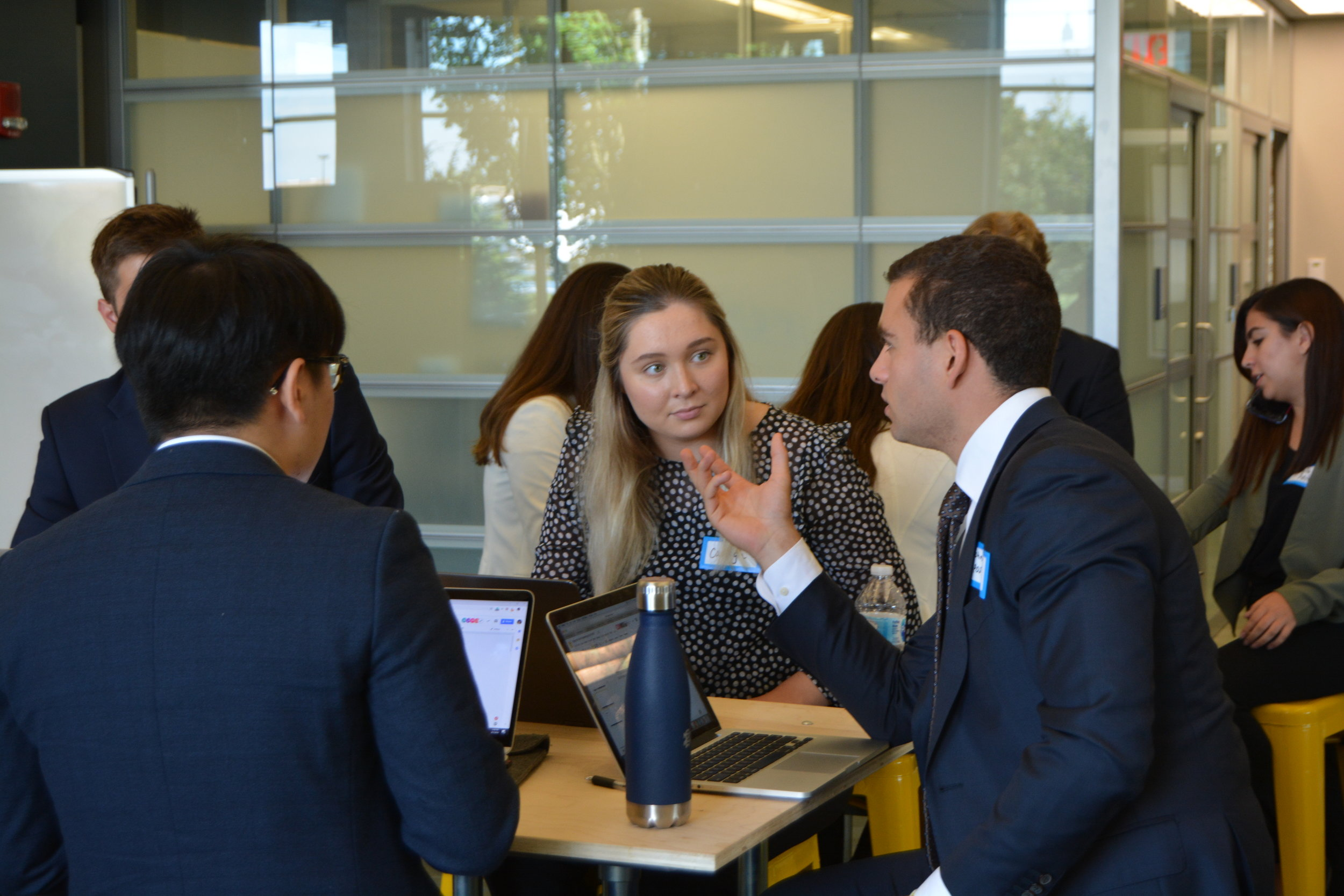 Students collaborate on consulting project during Notre Dame event.