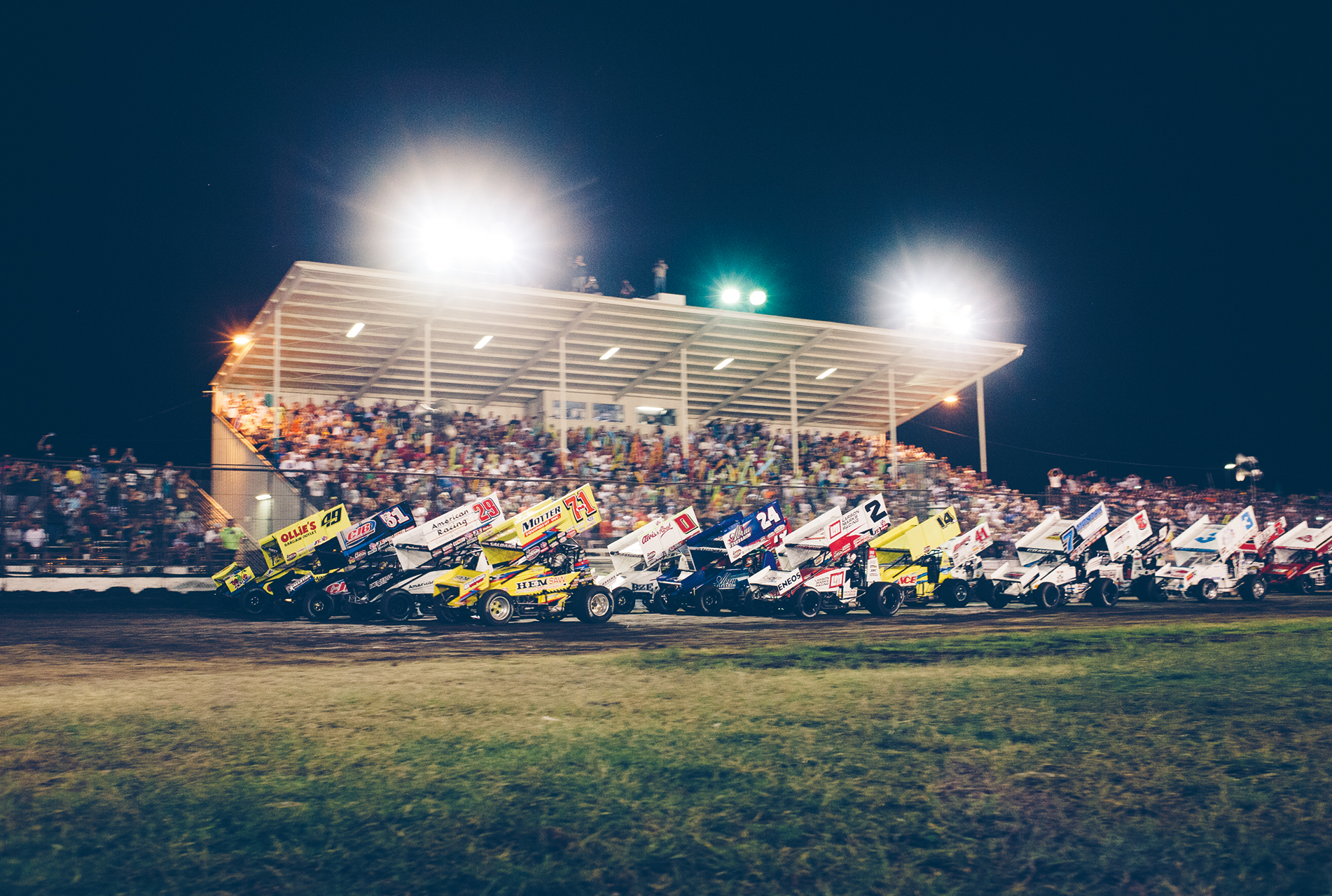 """410 winged sprint drivers """"salute the fans"""" before the start of the World of Outlaws/Gold Cup at Chico."""