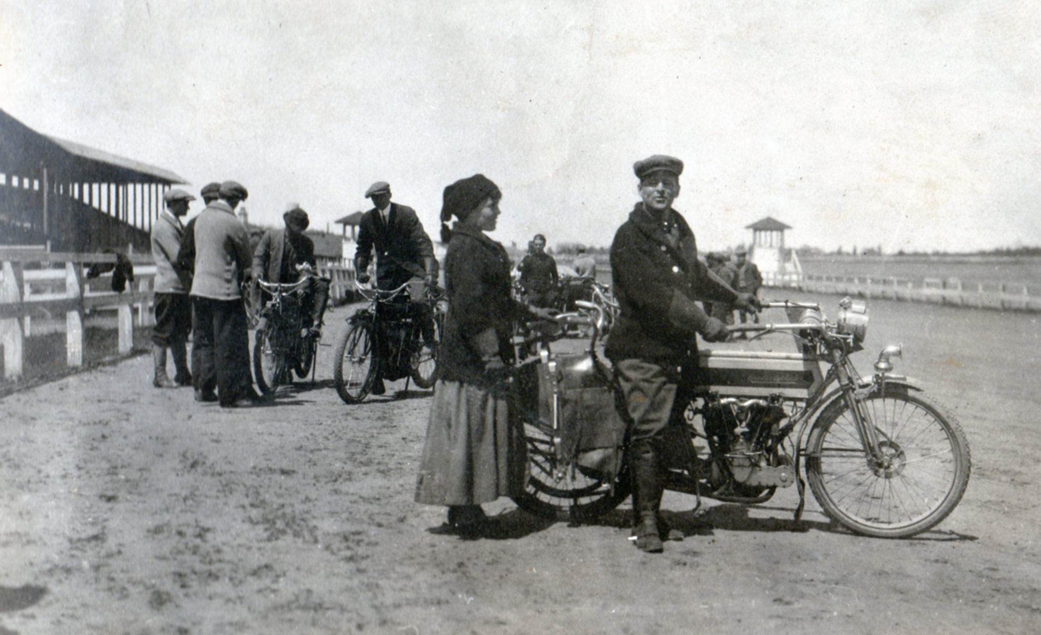 William and Elma at the track during race week. Langley served as a scorer at the races during the years he was involved in the business.