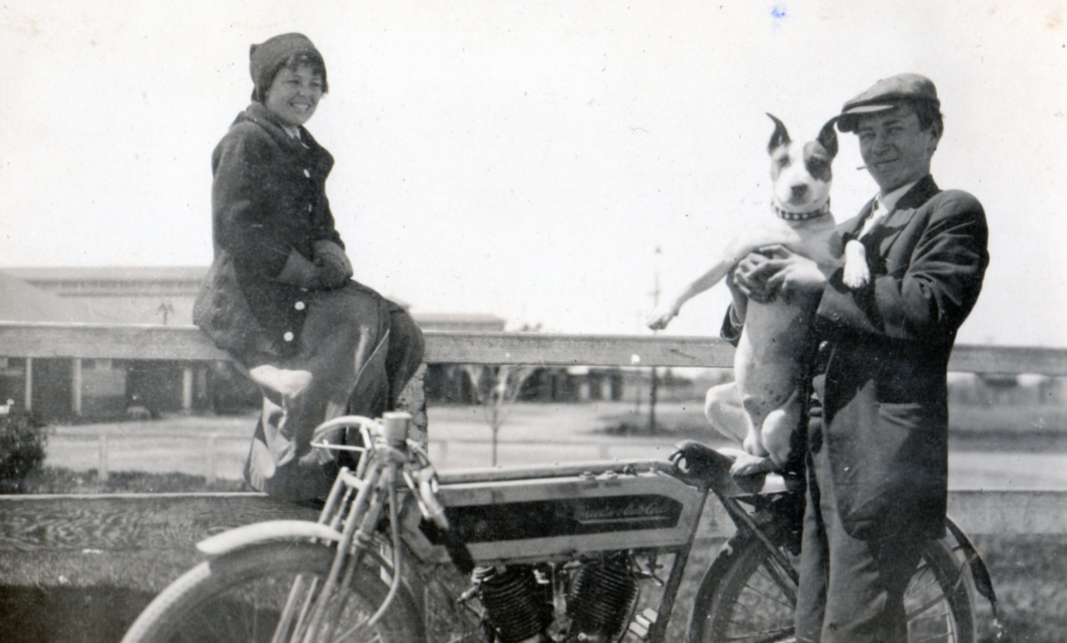 A charming shot of Elma Langley posing with a sporting lad with his bull dog.