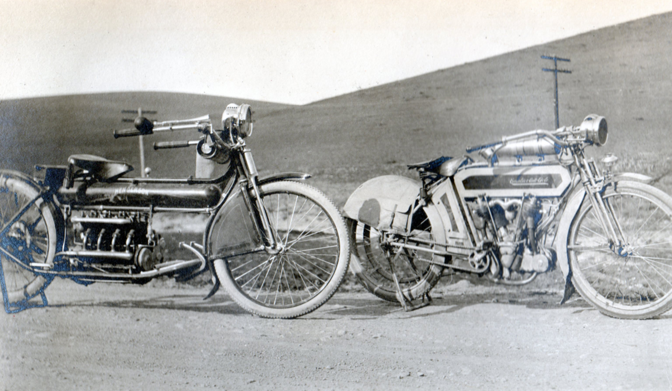 Out on the road. A first model 1912 Henderson and an Excelsior twin loaded with acessories.