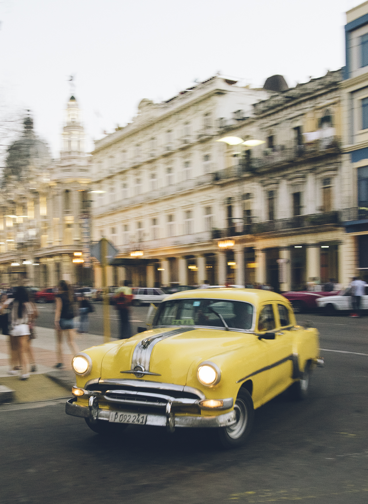 An early '50s Oldsmobile taxi makes the rounds near Havana's capitol building.