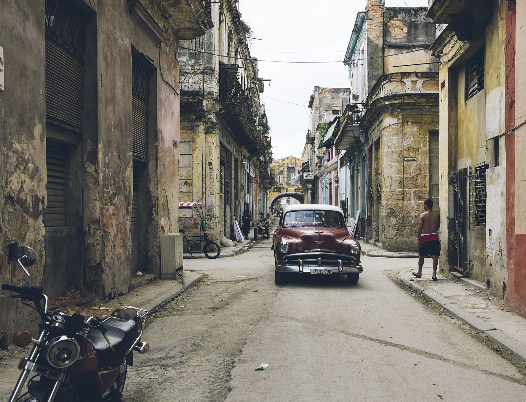 A 1953 Chevrolet lumbers through old Havana.