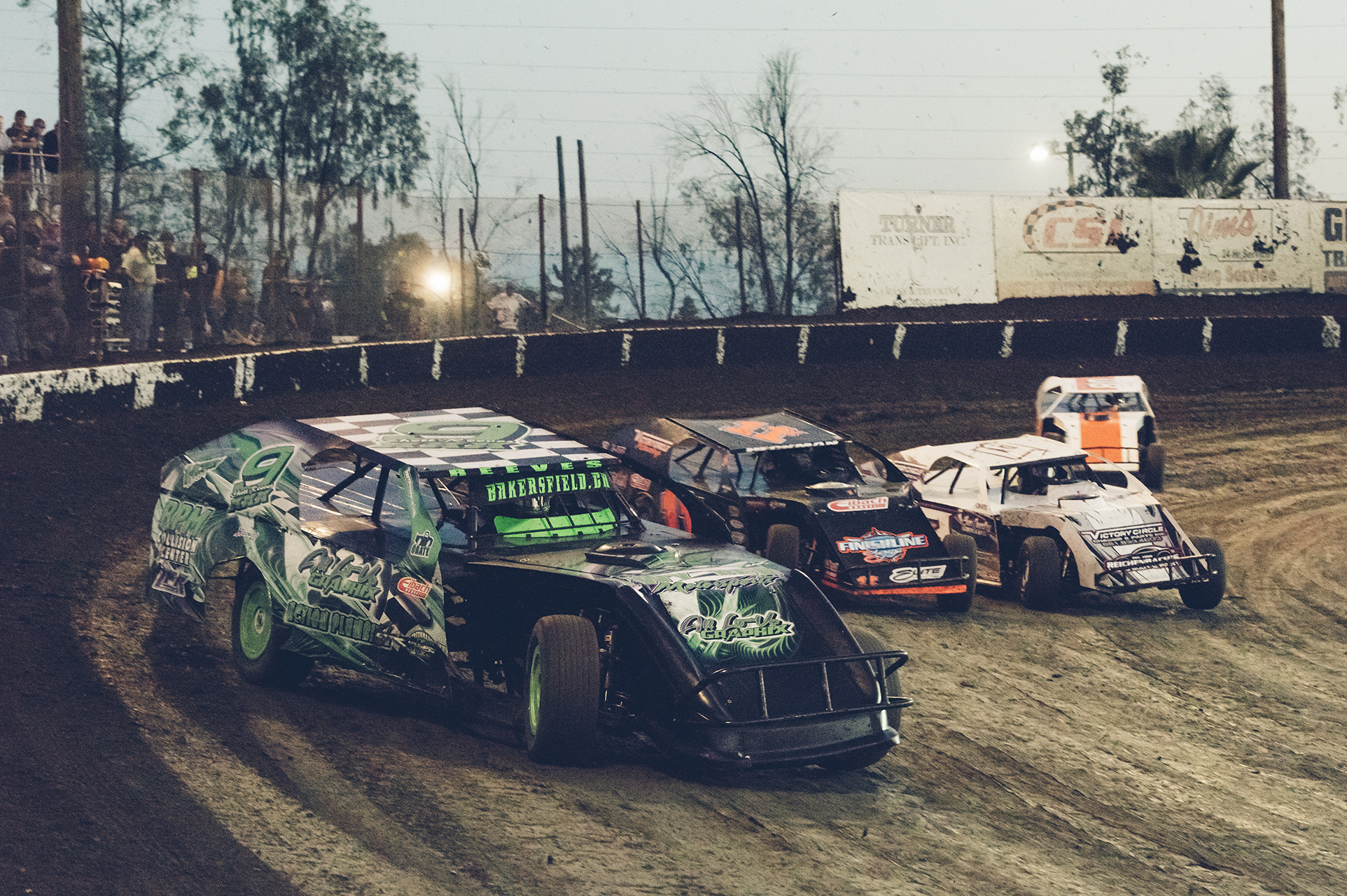 IMCA Modifieds accelerate out of turn two at Bakersfield.