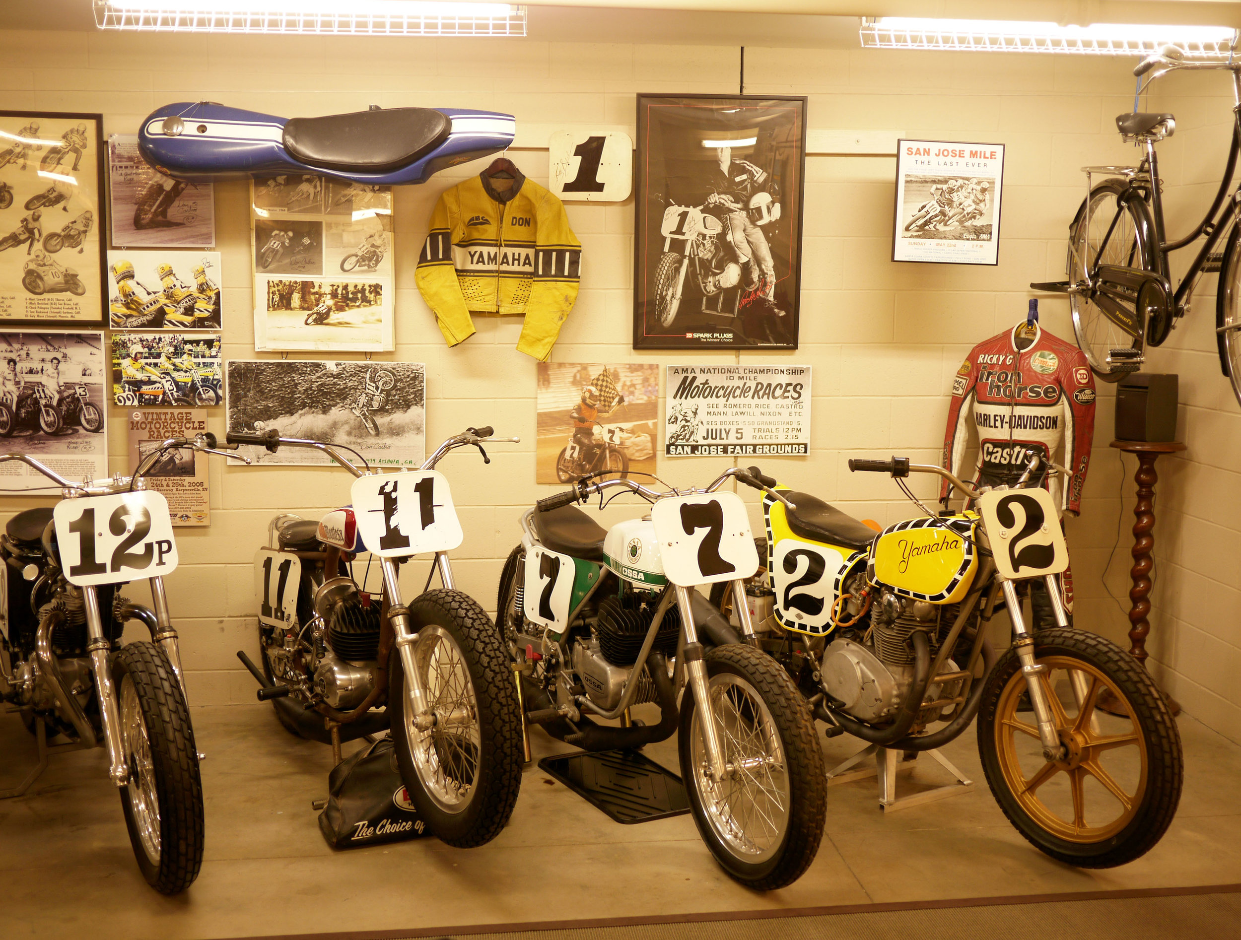 A lineup of classic flat trackers. On the right Kenny Robert's '74 title winning XS 650 based Yamaha.