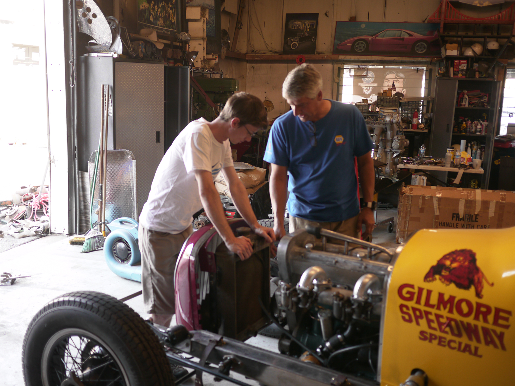Long and Mitch hooper confer on making alterations to the radiator mount on the Gilmore Speedway Special