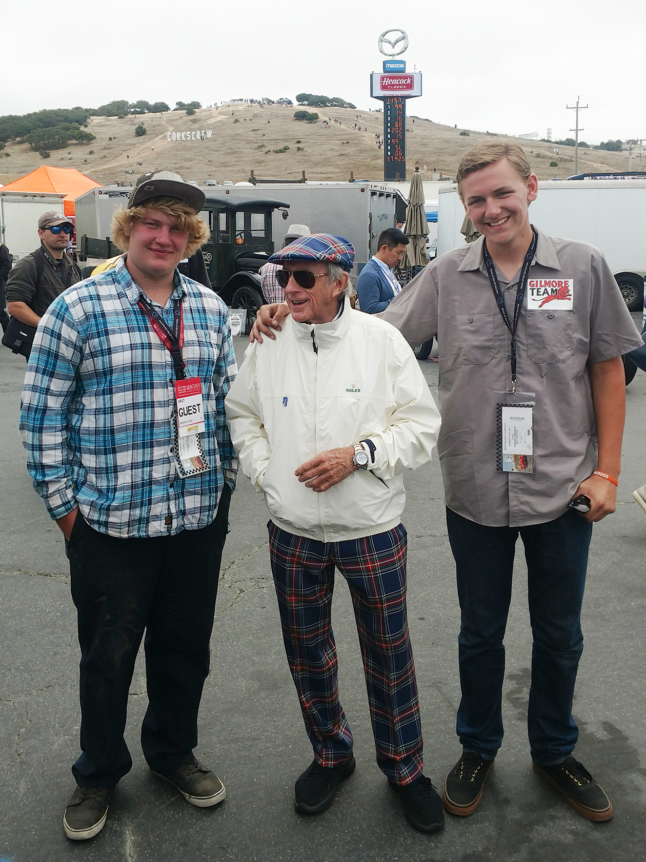 Students Brandon Clanton and Brandon Chaffing with racing legend and noted dandy, Sir Jackie Stewart. (courtesy of James Long)