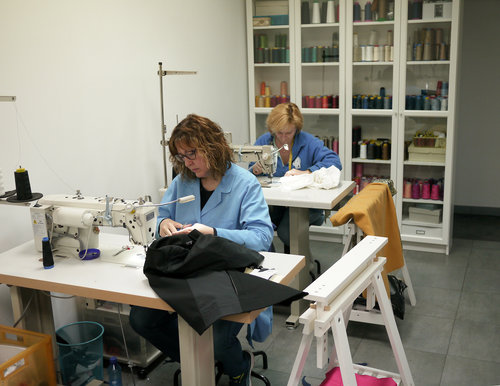 What is the feminine of 'craftsmanship,' I wonder? These women hand make the clothes.