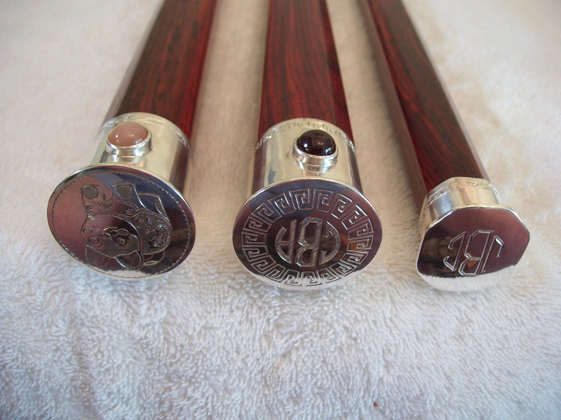Three canes made by the author with engraved silver heads. Two of them are set with semi-precious stones.
