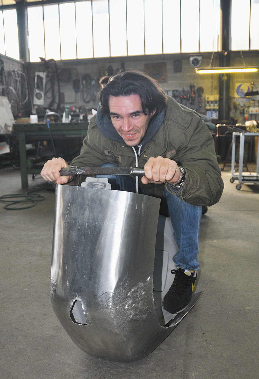Marco Fumagalli tests out one of the Vespas during construction.