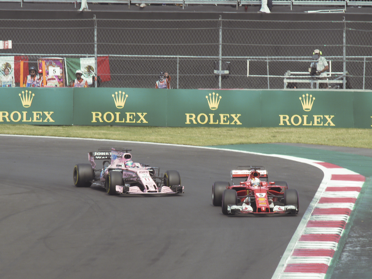 Four-time champion Sebastian Vettel passes Sergio Perez and his Mercedes-powered VJM10 Force India on his drive to a fourth-place finish. Perez held off Vettel for several laps. but the Ferrari driver was not to be denied.