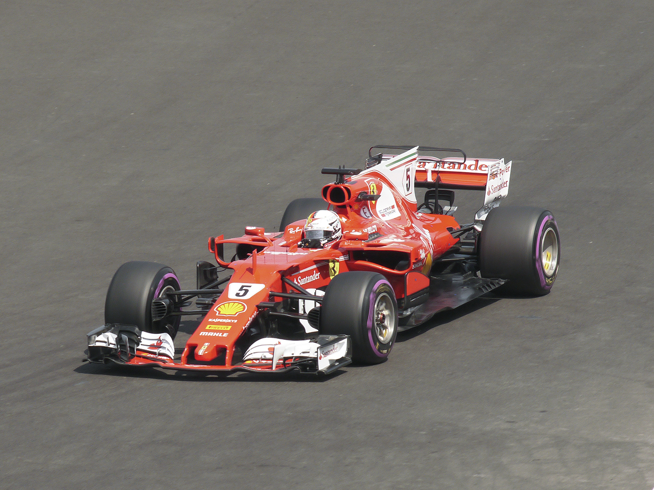 Ferrari had high hopes for a win when Sebastian Vettel put his car in pole position. But after a first lap collision Vettel had to hustle to finish fourth. The many little aero devices and wings funnel air around the car. Note how high the radiators have moved to catch air coming over the wheels. The flat carbon fiber floor extends almost to the outer edge of the wheels for high downforce.