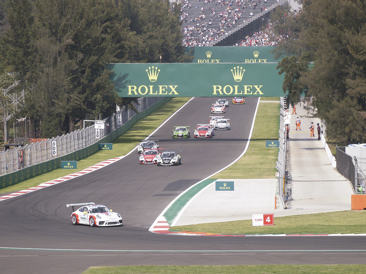 Matt Campbell leads the field into turn 4 on his way to a win in the first of the weekend's two Porsche Supercup races.