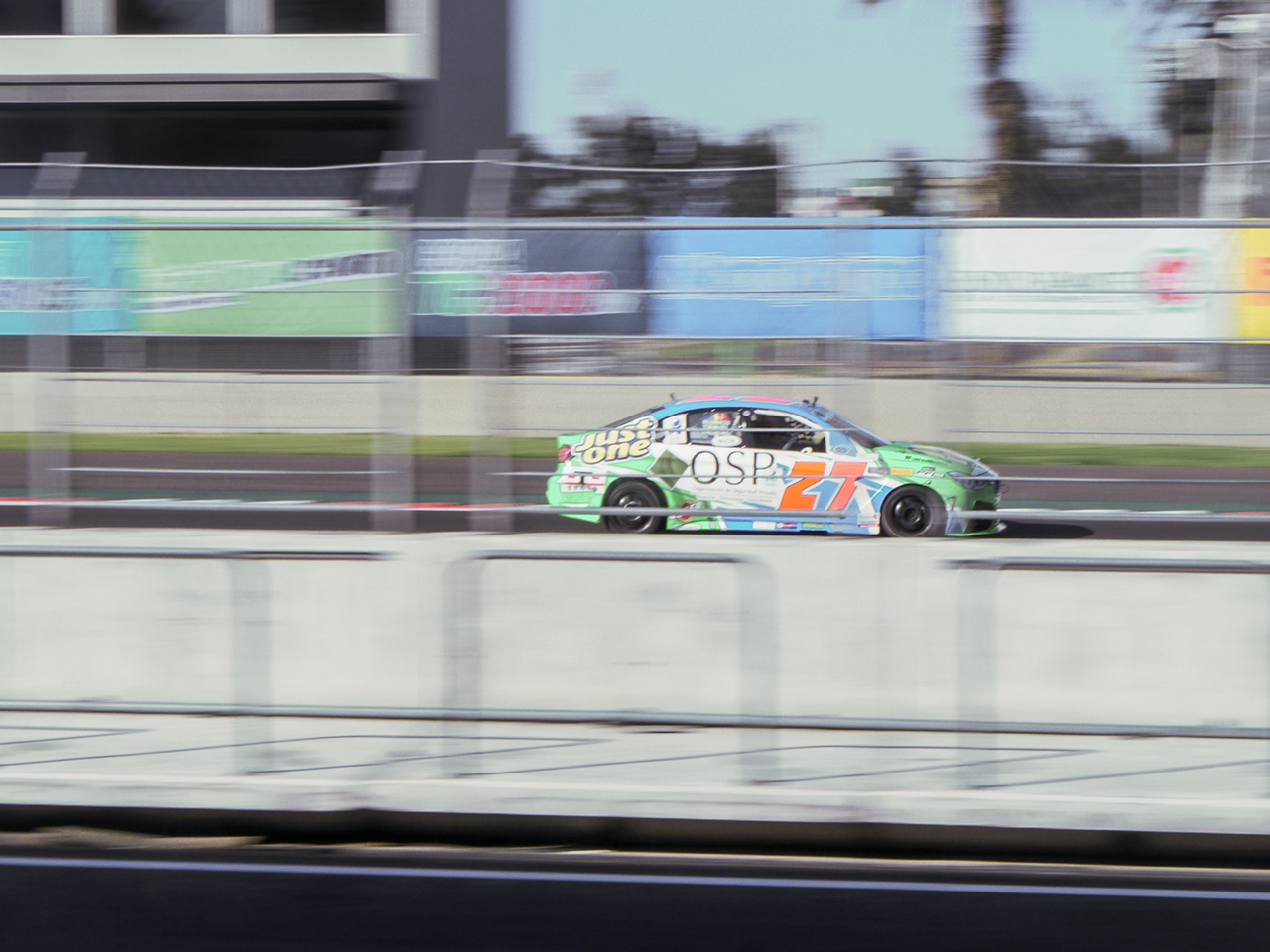 2.0 liter super touring car roars down the front straight.