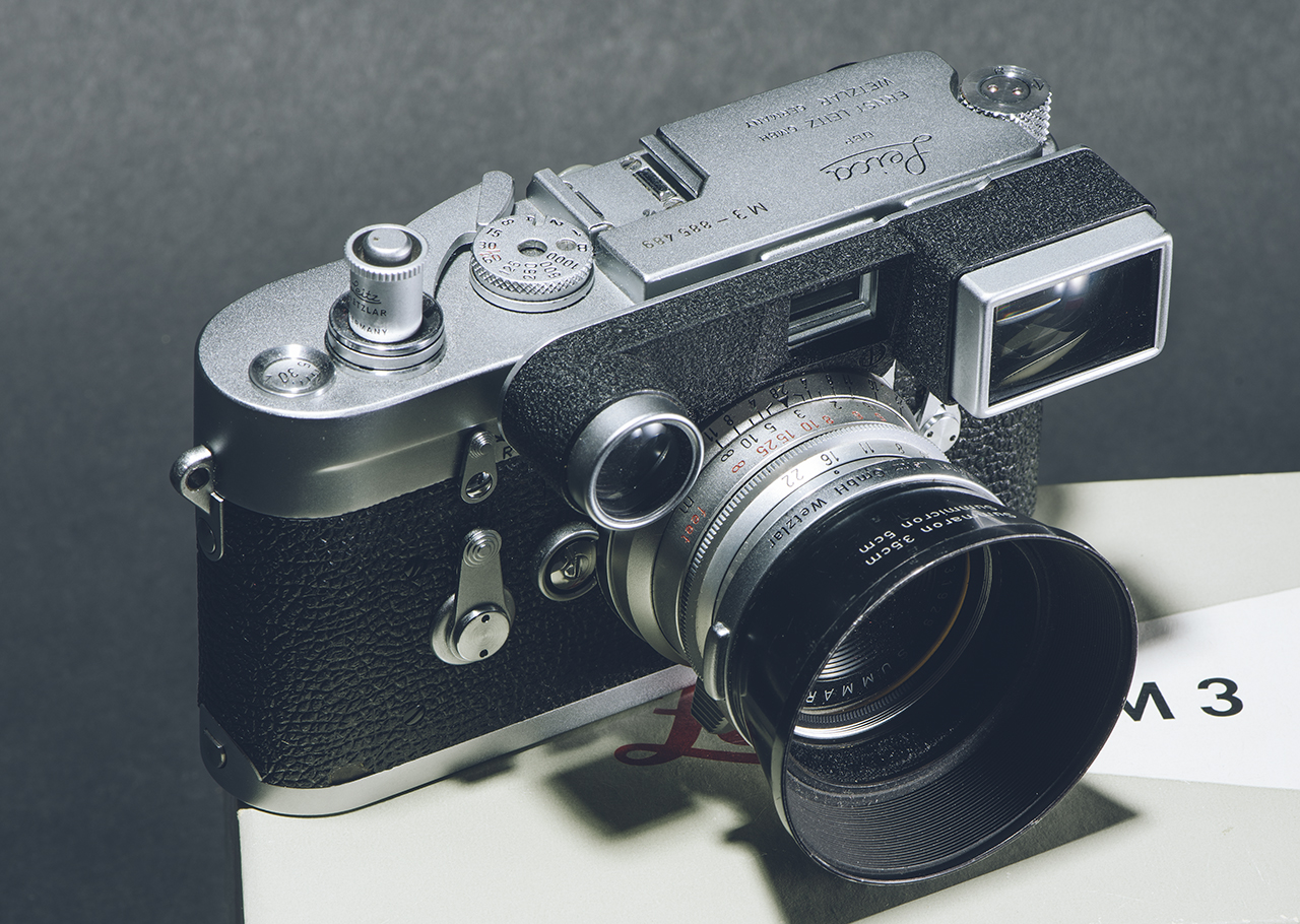 Leica M3 with a 2.8/35mm Summaron lens with goggles to give a 35mm view. The M3 did not have 35mm bright lines in the viewfinder. The shutter release is a rare Leica accessory.