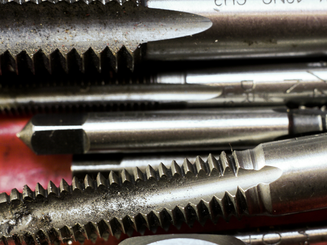A group of taps. These tools are used to cut threads in holes.